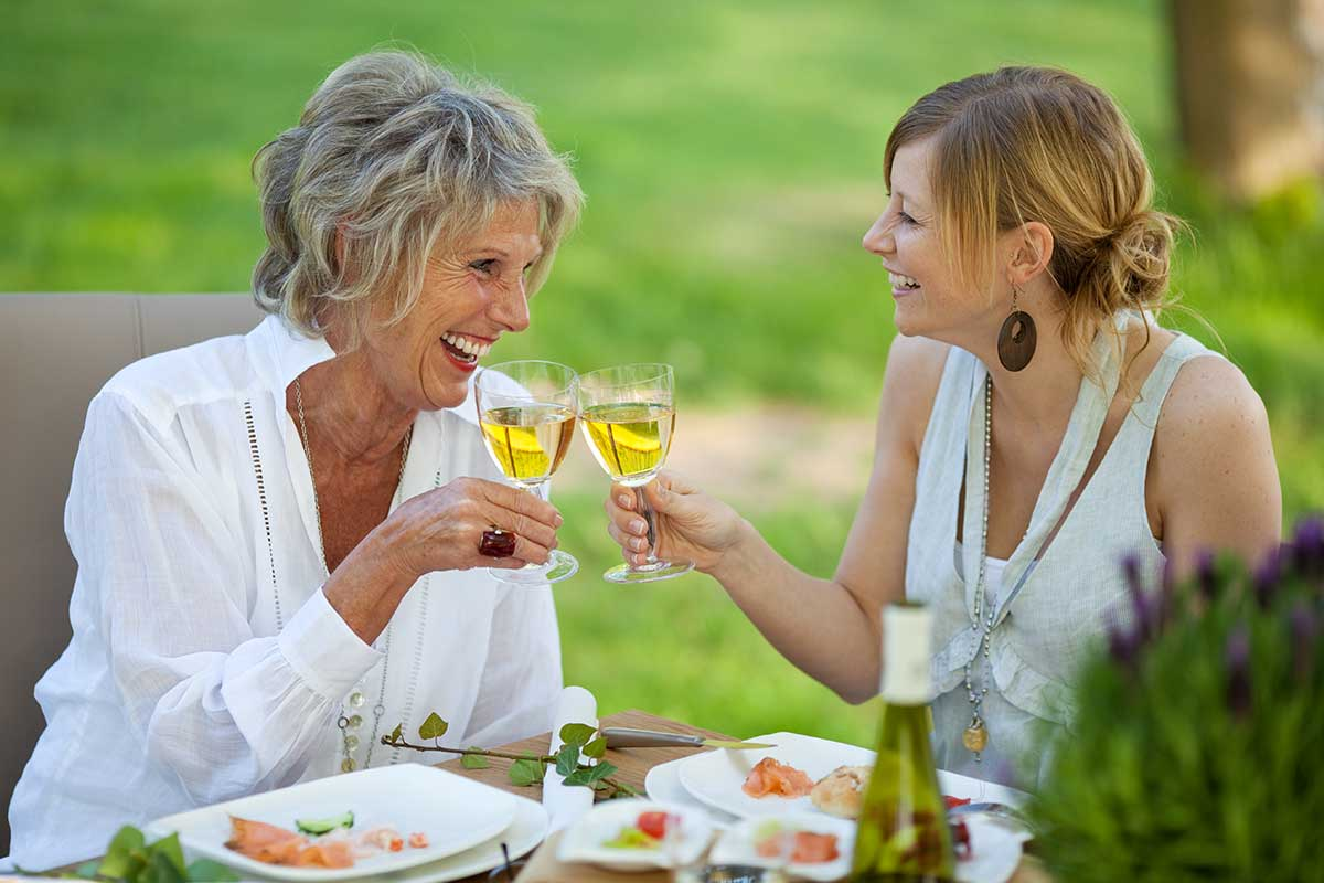 dental implant patients enjoying wine in new hyde park